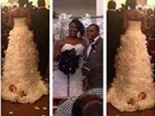 Idiot Black Female Straps A 1 Month Old Infant To The Back Of Her Wedding Dress As A Fashion Statement! (Video)