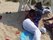 Man Records Black Life Guard Sleeping On Duty With Her Two Bastard Kids In Tow! (Video)