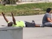 Black Man Shot By The White Cop While Laying Down With His Hands UP!  (Video)